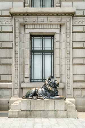 European style windows with an outdoor sculpture