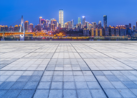 Urban square with night skyline of commercial buildings in China