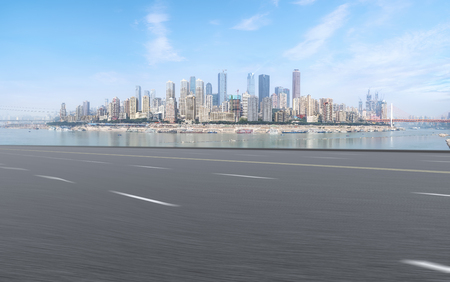 Empty asphalt road with skyline of commercial buildings in China