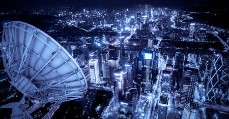 Satellite signal receiver over the city Stock Photo