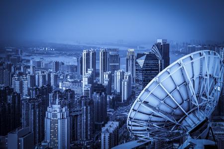 Satellite dish above the city Standard-Bild