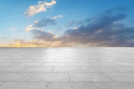 Empty marble tile floor and sky cloud landscape