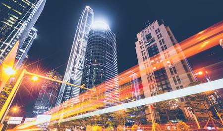 City night view building street and blurred headlights Foto de archivo