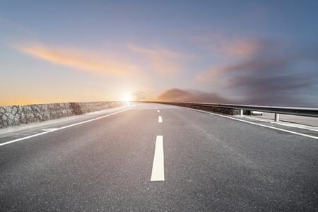 Asphalt highway and sky clouds