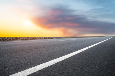 Asphalt highway and sky evening clouds