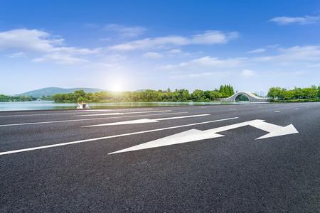 Asphalt road and green lakes