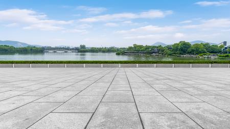 Square floor tiles and natural landscape