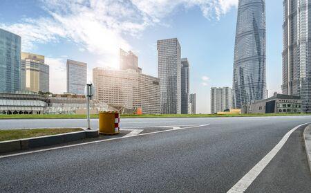 Road and Shanghai city building skyline