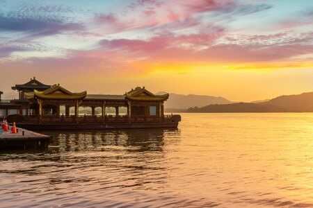 Evening glow of Hangzhou West Lake cruise