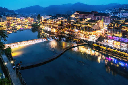 Aerial photography of the night scene of Fenghuang ancient city