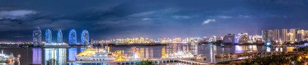 Aerial photography of skyline night scene of Sanya Bay Phoenix Island architectural landscape