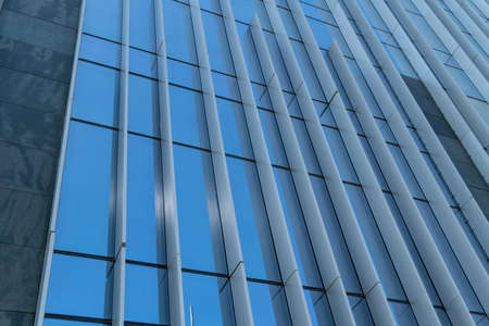 Low angle shot of glass exterior wall of office building 版權商用圖片
