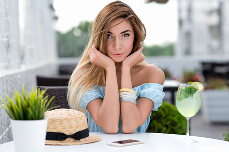 Portrait tender sensual beautiful woman summer cafe. Happy smiles anticipation communication, conversation. Long hair tanned skin everyday makeup positive thoughts rest after working, date restaurant