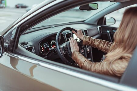 A woman in car, clicks on horn, emergency braking, alarm, car sound, accident prevention, emergency on the highway, braking the car to a complete stop. Girl in a jacket in summer and autumn