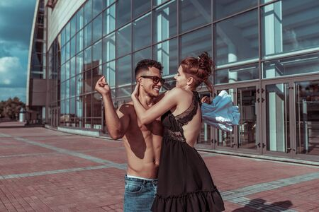 Young couple girl and man dancer happy play have fun laugh, dance glass windows background, summer city, hip hop style breakdancer. Active youth lifestyle modern fashionable hipster couple street