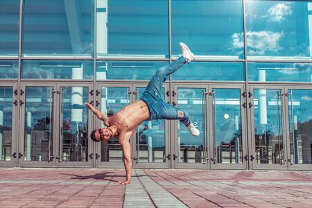 Male dancer dancing in summer city, break dance, fashionable and modern hip-hop dance style. Street lifestyle. Free space for copy text Stok Fotoğraf