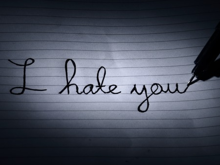hatred: An expression of hatred, written on a piece of paper in the darkness