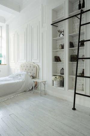 Stylish luxury white bedroom interior design in soft day light with elegant classic furniture Reklamní fotografie