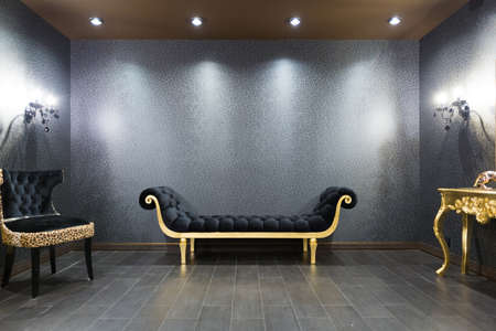 luxurious romantic room in a pompous style in black and gold colors with magnificent furniture