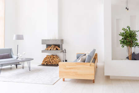 Luxury fashionable modern design studio apartment with a free layout in a minimal style. very bright huge spacious room with white walls and wooden elements. Banco de Imagens