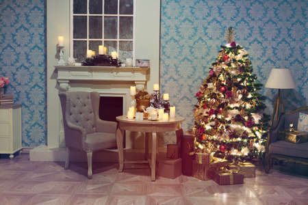 Luxury interior of living room with decorated Christmas tree and gifts on the wooden floor