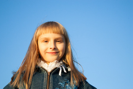 suntanned: young girl in the sunset light in autumn