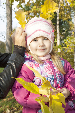 belonging to the caucasoid race: Sweet little girl in the autumn forest