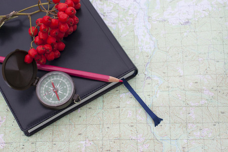 scientific expedition  on the map. compass. knife Archivio Fotografico