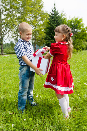 happy adorable  kids with gift in park. photo