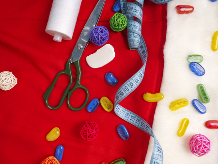 craft supplies: Christmas sewing still life includes fabric and craft supplies for creating festive decorations and ornaments.