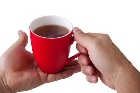 red hand: Hand hold red mug on white background.. isolated Stock Photo