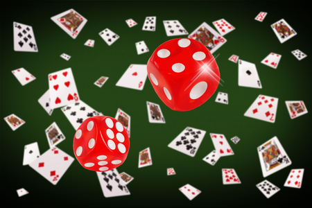 bonanza: Playing cards an dice flying at the poker table. Stock Photo