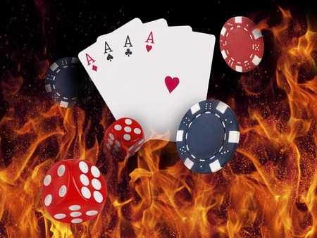 Playing cards and casino chips on fire. poker concept.