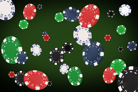 free image: Playing chips flying at the poker table.