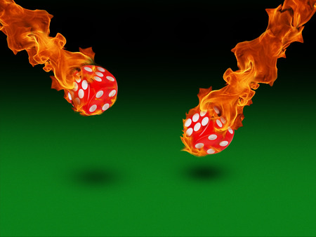 burning money: Red dice in a fire. casino concept.