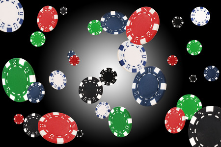 Playing chips flying at the white-black background Stock Photo