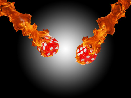 burning money: Red dice in a fire. casino concept. white- black background