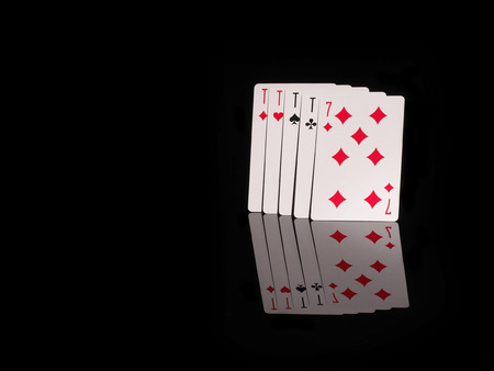 four of a kind: Four of a Kind playing cards isolated on black background. casino concept