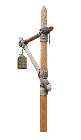 Vintage street lamp on a wooden post. isolated on white background Stock Photo
