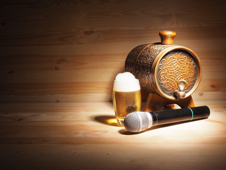 bard: Barrel and glass of beer, microphone on wooden background. concept karaoke.