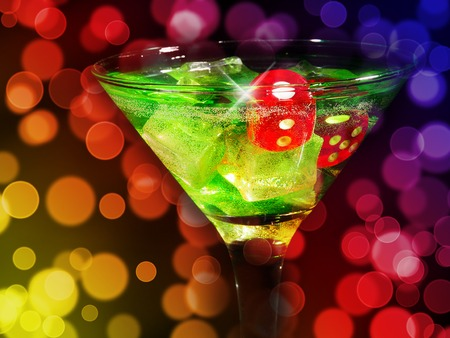 Red dice in a cocktail glass on bokeh background. casino series.