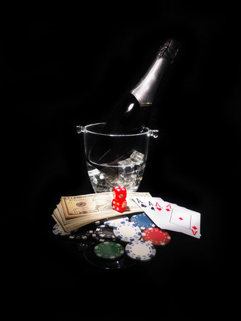 bucket of money: Playing cards and a bottle of champagne in bucket.