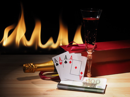 Playing cards and a bottle of champagne in box.