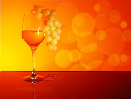 Glass of White Wine on Sunset backgraund Stock Photo