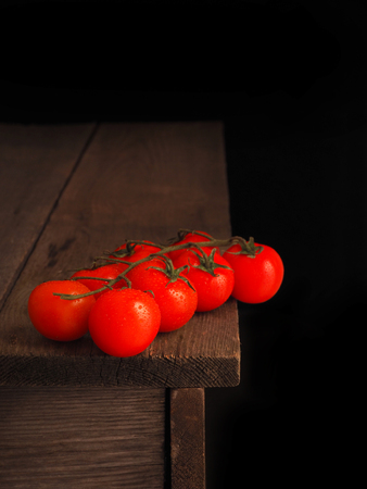 Fresh tasty tomatoes on old rustic table.