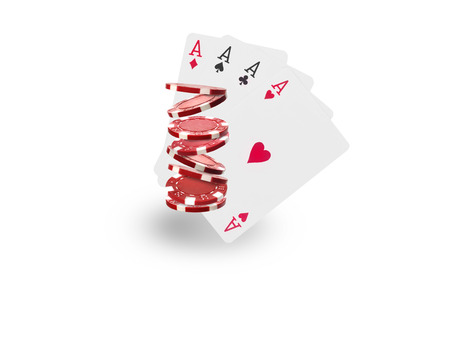 Playing chips flying at the white background.
