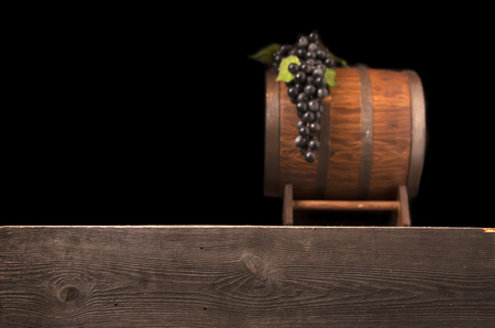 Rustic blurred wooden barrel on a night background.
