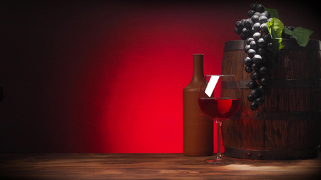 glass of red wine and rustic barrel. Red accent.