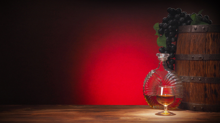 Glass of cognac with barrel on red background