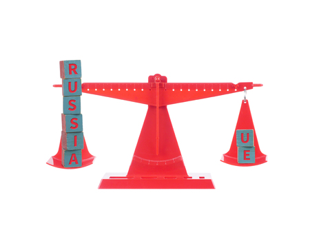 Red seesaw with two balanced concept of wooden cubes.